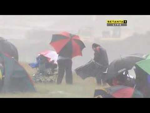 Touring car fans fight the weather!