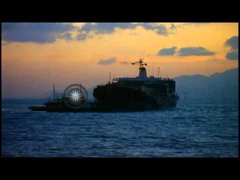 Tugboats guide a cargo ship towards pier at Cam Ranh Bay in Khanh Hoa, Vietnam HD Stock Footage