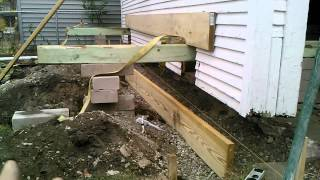 Ron Quinn lifting a 2 car garage to replace the footer.