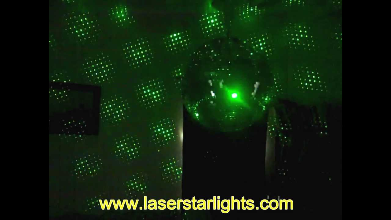 green laser star lights with disco ball projector shines on mirror