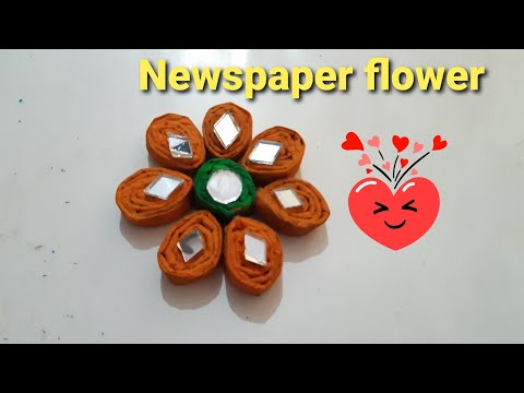 Simple and nice newspaper quilled flower using newspaper