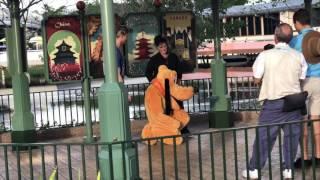 Woman Brings Monkey to Meet Pluto at Walt Dis...