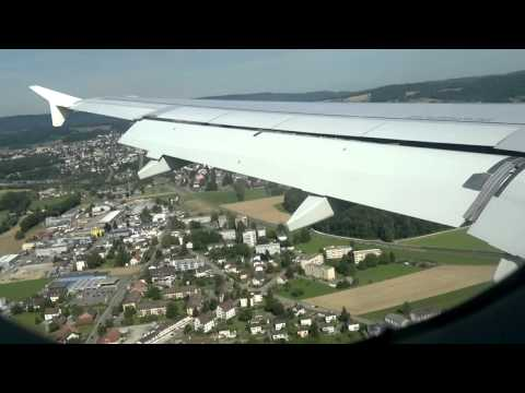 Landing at zurich Int'l Airport, wing view. A320 - real pilot