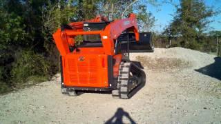 Kubota SVL90 loading dump truck