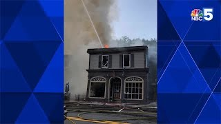 Crews battling large fire on Central Street in Woodstock