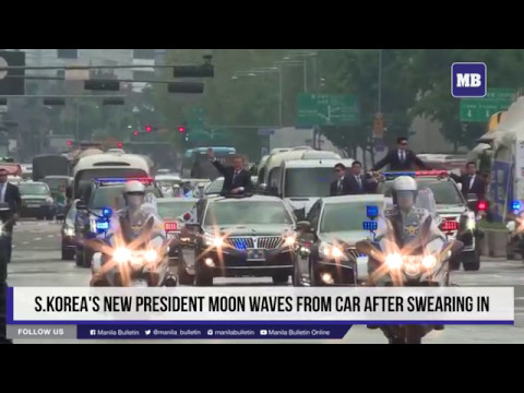 S.Korea's new President Moon waves from car after swearing in