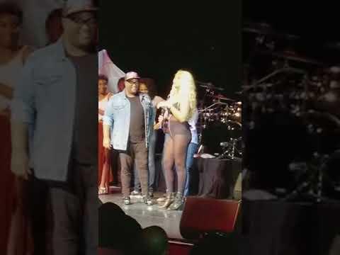 Monique Coward singing alongside Tamar Braxton