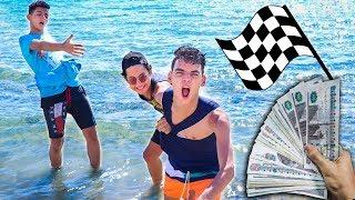 عملنا سباق اول واحد يطلع من البحر يكسب 10.000 جنيه !! (وقعوني في البحر )