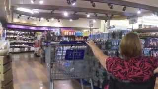 L1 paraplegic with Spina Bifida pushing a grocery cart