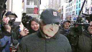 BERNIE MADOFF gets shoved by a News Photographer