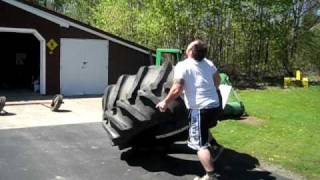 Strongman Tim Moss flips a 1,000-pound tire