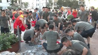 Some troops from PLA Hong Kong Garrison assist local residents in clearing roadblocks