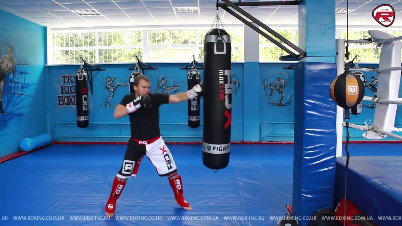 Отработка ударов на боксерском мешке RDX. Боксерские перчатки RDX .