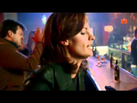 female detective handcuffing in a bar