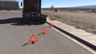 weekly truck and travel tip putting your triangles out
