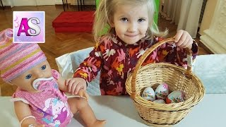 Baby born helps to open KINDER SURPRISE EGGS