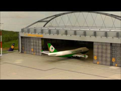 HO scale 1:87,  Boeing 747-400F EVA Air Cargo taxi, take off, land, taxi, go into hangar, ...