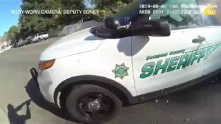 Body cam footage: Deputy shoots suspect who entered his police car