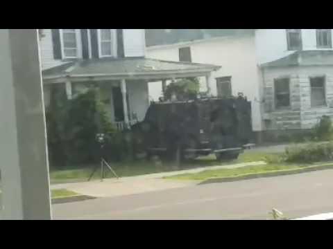 Militarized state police vehicle rams through door in Massena