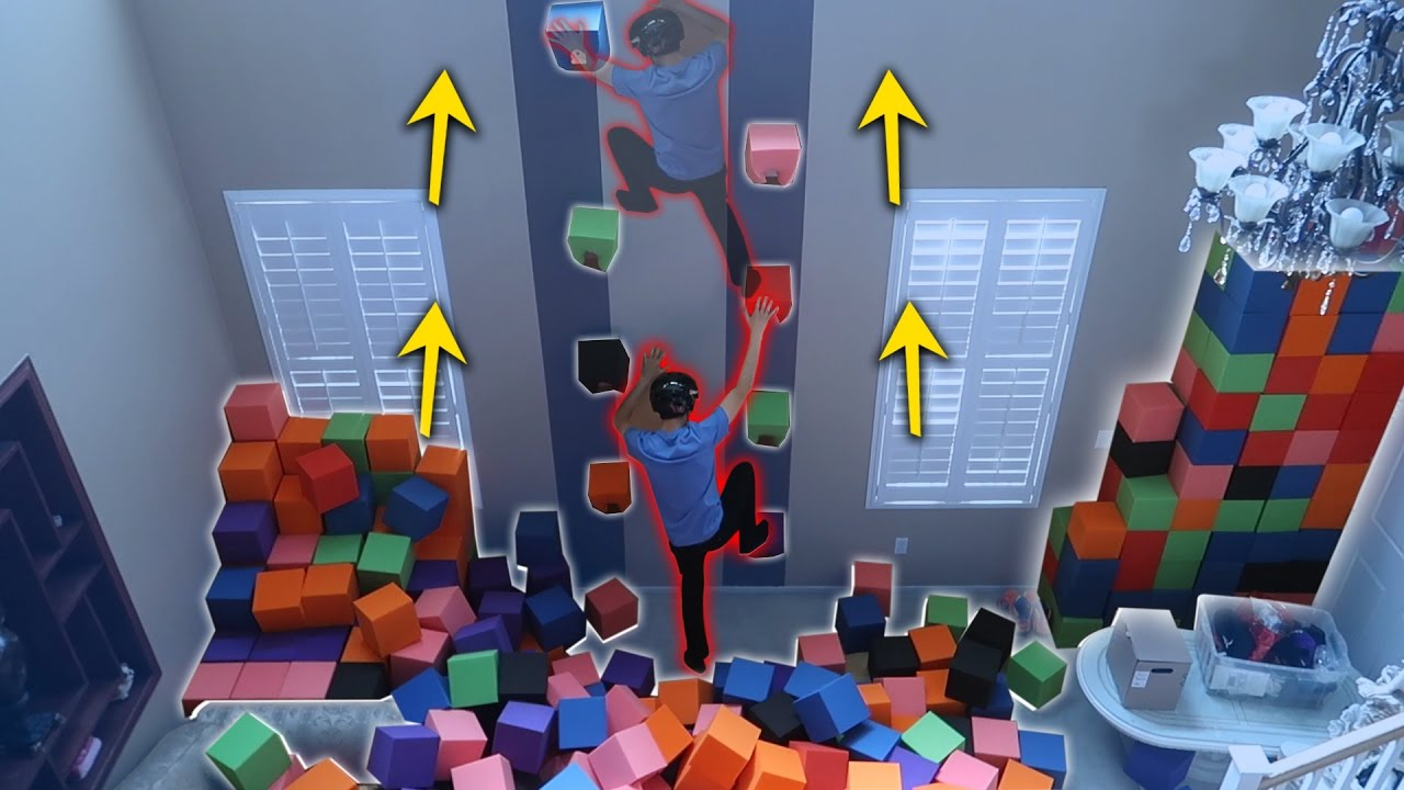 indoor-rock-climbing-with-the-foam-pit-attempting-to-climb-up
