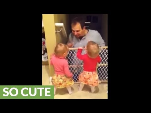 Identical twins ecstatic when dad comes home