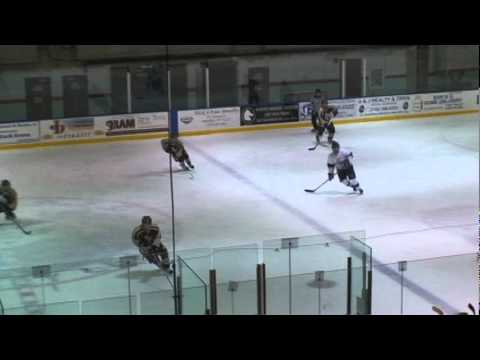 Slava Okshin throws a body check agains Iona Prep HS