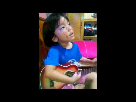 Indonesia church bomb attack victim Trinity, 5, playing the guitar