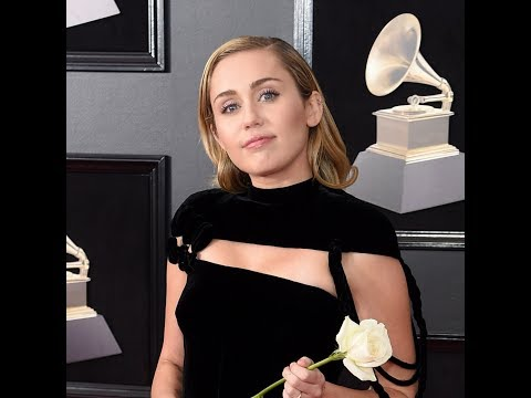 Miley Cyrus Wears A Black Pantsuit To Grammys 2018 And Carried A White Rose To