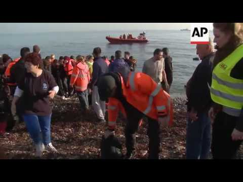 Raw: Thousands of Migrants Reach Lesbos