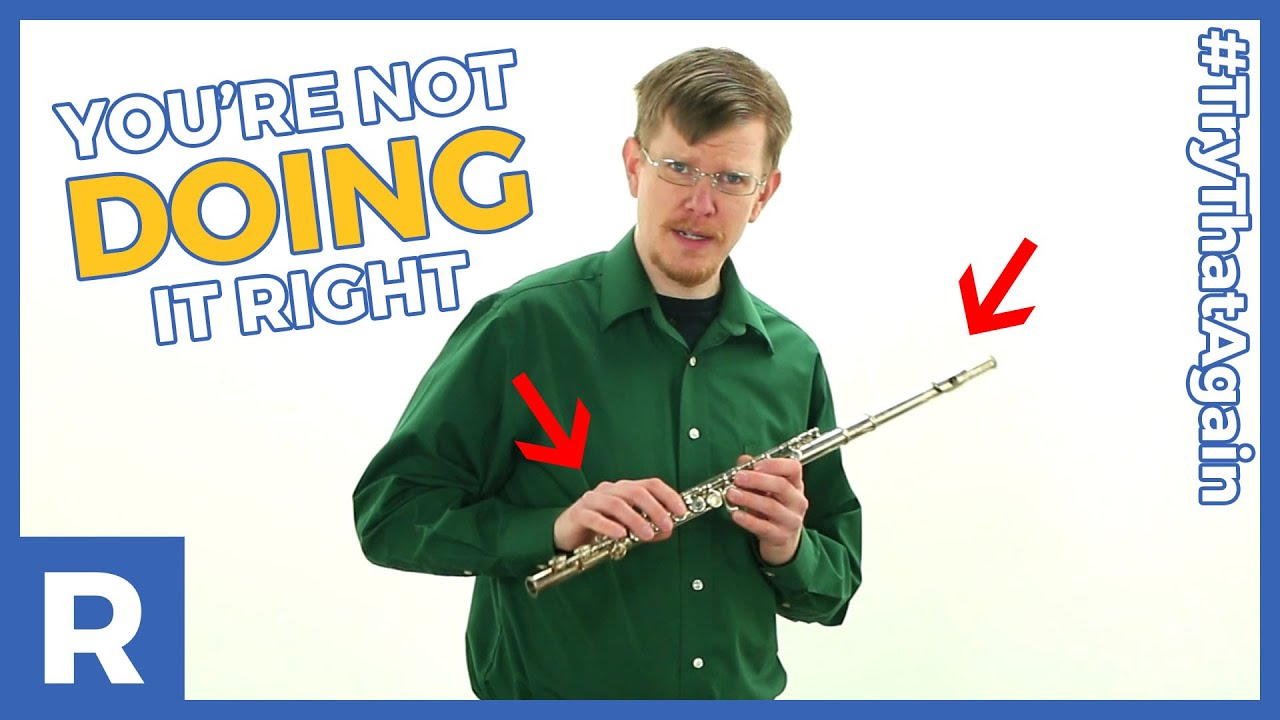 Daniel M. Reck completely fails to hold a flute properly.