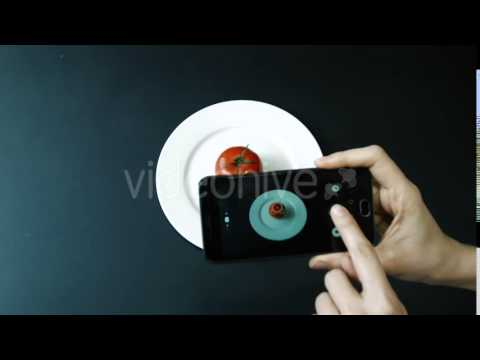Photography Plate With Tomato on a Black Table