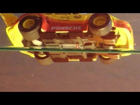 Tried to film a Tyco slot car from below with the pin between two glass-plates, some slow motion