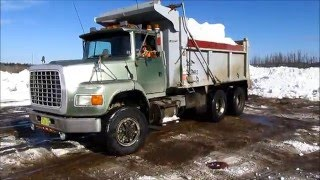 Ford L 9000 Dumping Snow