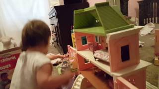 Twin babies making their toy figurine dad go potty