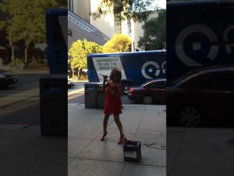 Tina Turner lookalike on Michigan Avenue performing