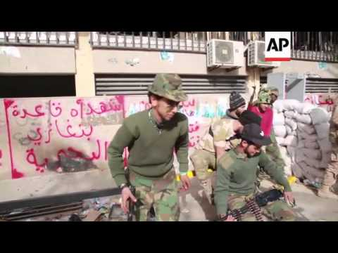 Military forces outside central bank after taking it from militants