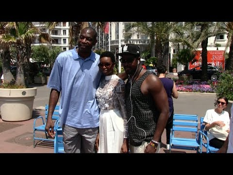 Maria Borges takes a pose with legendary NBA player Dikembe Mutombo in Cannes