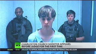 Charleston massacre shooter faces family of victims in court
