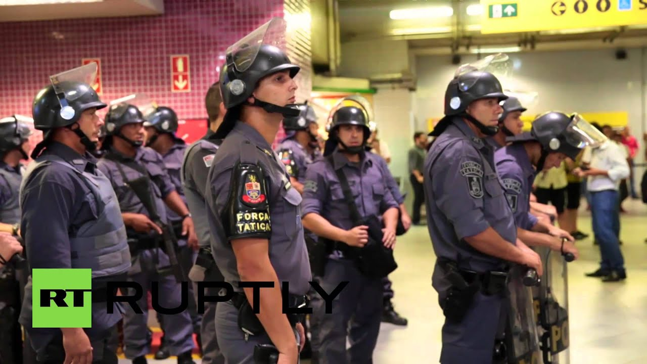 Brazil: See riot police TEAR GAS protesters in subway station - YouTube