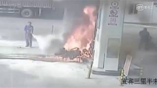 Oil suppliers put out fire on a motorcycle in a gas station in SW China