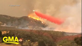 Residents in Southern California evacuate as massive wildfire grows