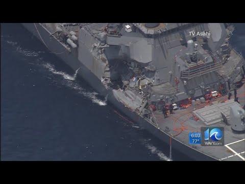 Damaged USS John S. McCain arrives in Singapore