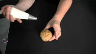 frosting-icing-a-cupcake-using-a-1a-round-tip