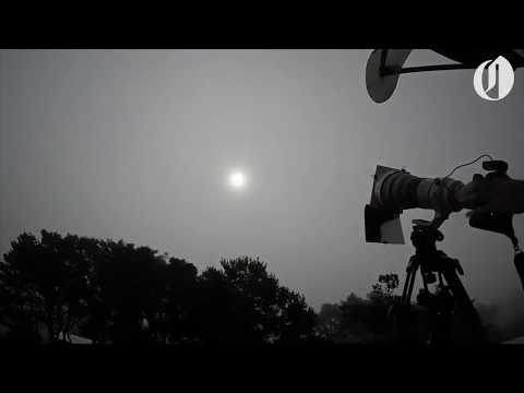 Oregonian photographer capturing the 2017 solar eclipse from a rooftop in Depoe Bay (time lapse)