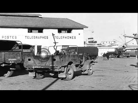 Allied Military Equipment And Trucks Being Unloaded By British At A Port In North...HD Stock Footage