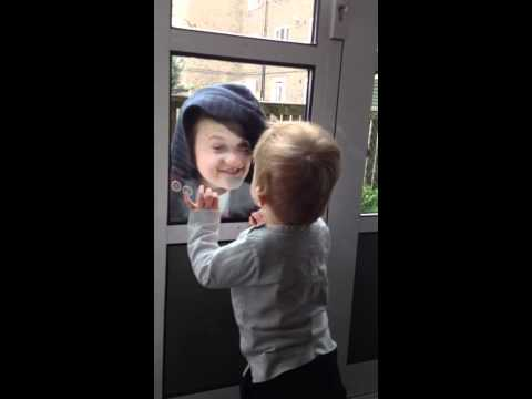 Reece Buttery and Charlie Barrow playing at the window
