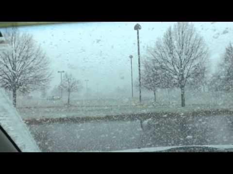 Flint,MI snowing near movie theater.