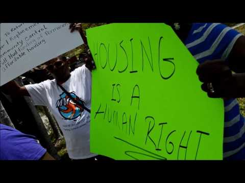 Download Youtube: Members of the Miami Workers Center protest as Housing and Urban Development (HUD) secretary, Ben Ca