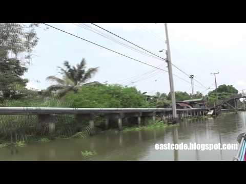 Thai canal with concrete pathway