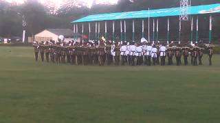 THE KENYA POLICE BAND SHOWING THEIR MOVES.